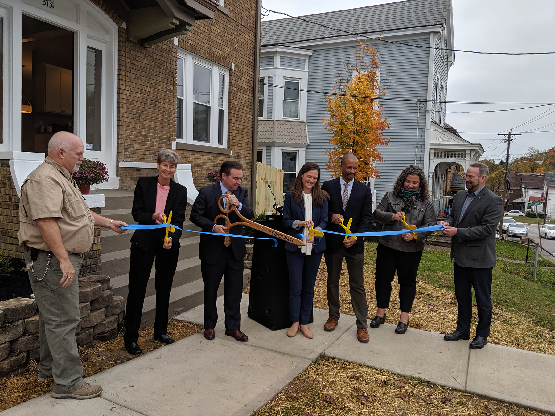 Photo of official ribbon cutting in front of Price Hill home on St. Lawrence Avenue