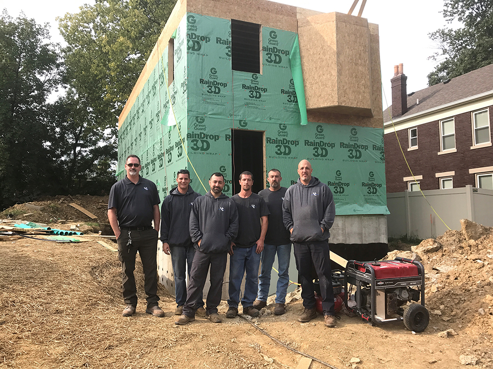 Unlimited carpentry team in front of their latest new home build in Evanston